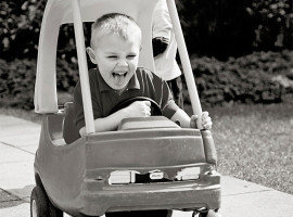 Boy riding toy car