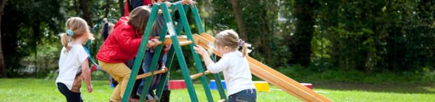 Pre-school kids on a slide