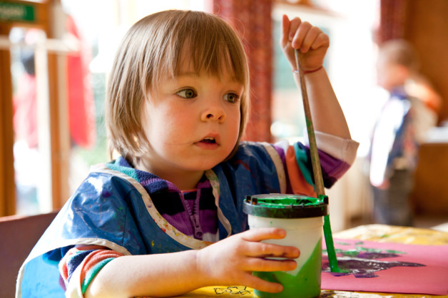 Image of toddler girl painting